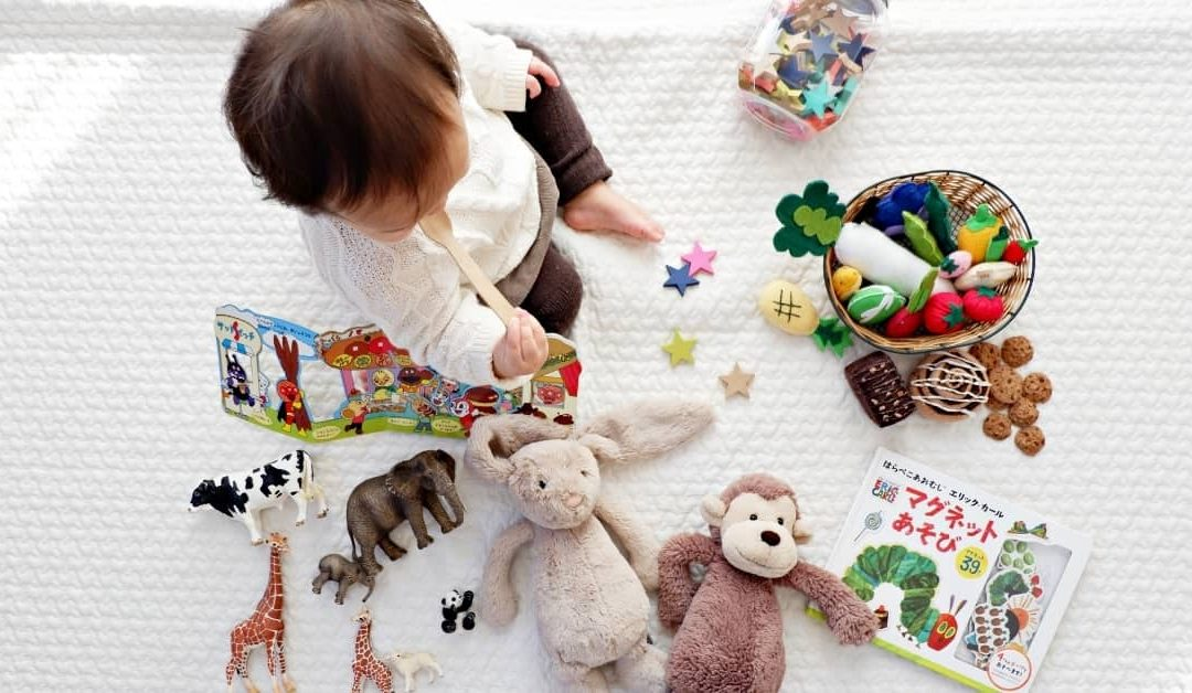 Overhead shot of a baby playing with various toys