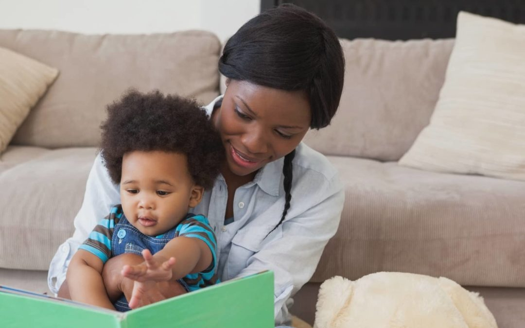 A woman reading to her baby